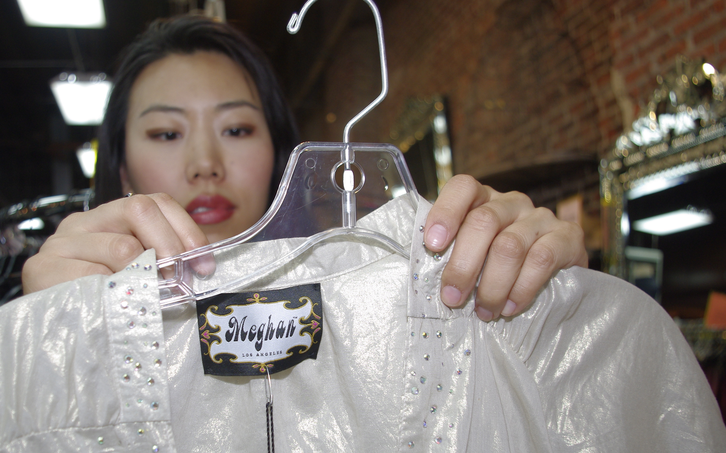 Jina Huh inspects a blouse by Meghan.