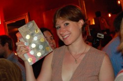 A lucky raffle winner revels in her victory