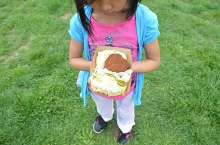 Raising the next generation of foodies, thanks to the crab cake sandwich from Jeffrey's Grocery. Photo by Mary Dorn