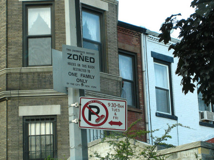 """New signs will say """"Zoned for rich people only."""" via Flickr user the real janelle"""