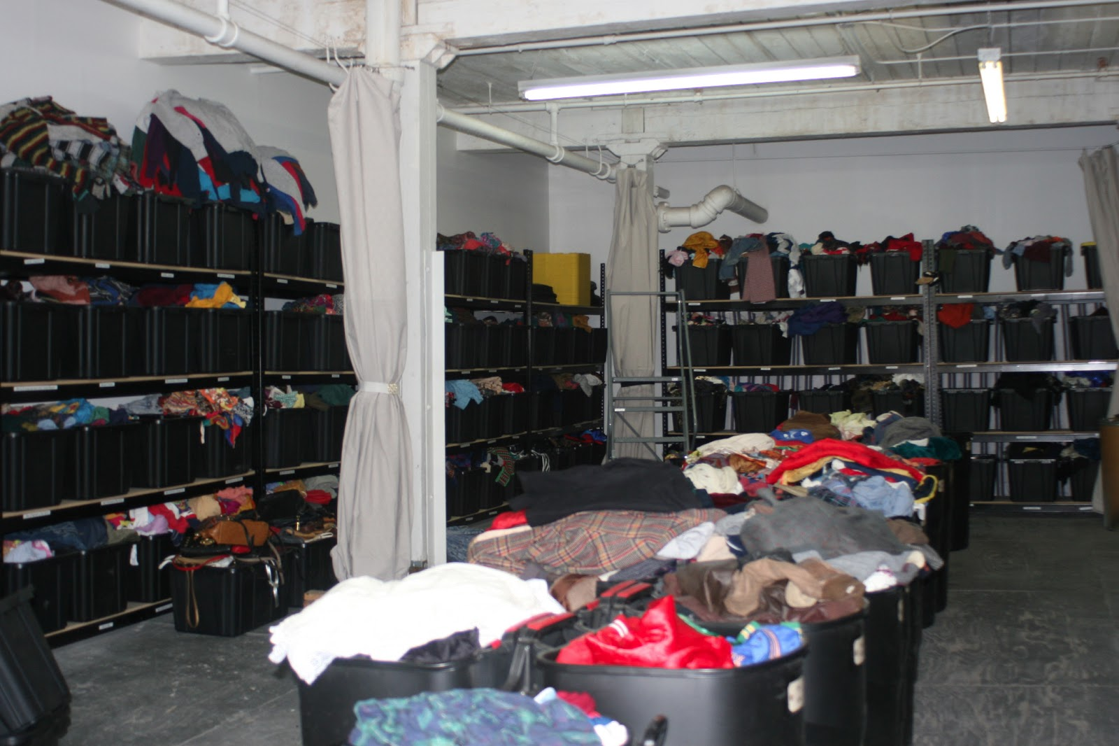 Just picture this room full of people stuffing clothes in a bag