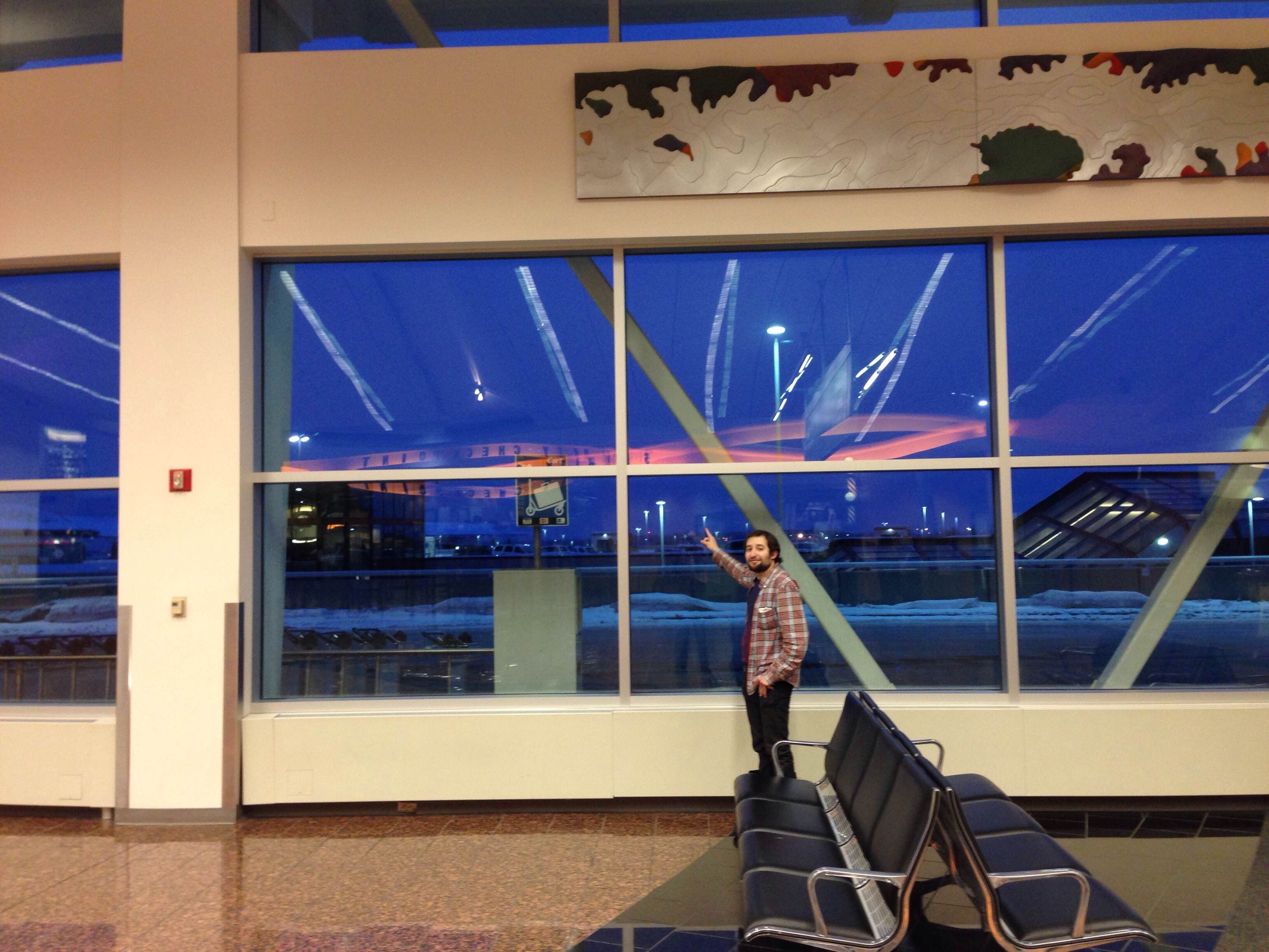 """Dave enjoying the """"aurora borealis,"""" also known as the reflection of the airport lights."""