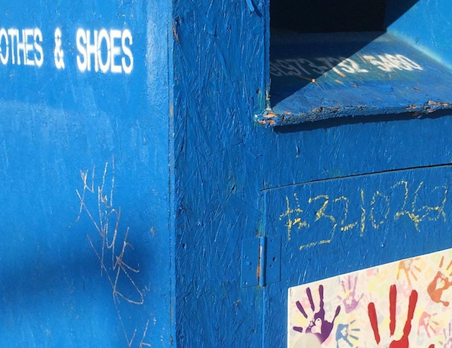wooden clothes donation bin