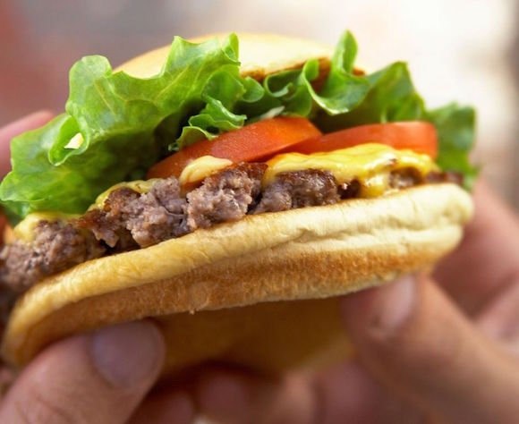 Shake Shack making it rain free breakfast sandwiches and burgers on Wall Street today
