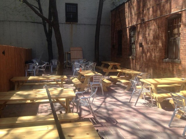The shade-dappled backyard of Nostrand Avenue Pub is waiting for you. Via Facebook.