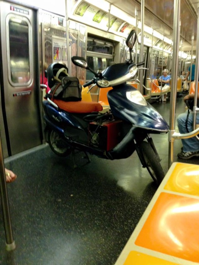 Come on now, the D train is no place for your giant electric scooter
