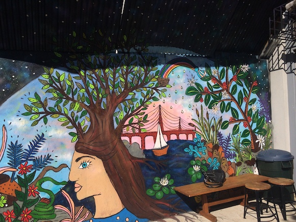 Mural art at Kings Coffee, painted by a neighborhood artist.