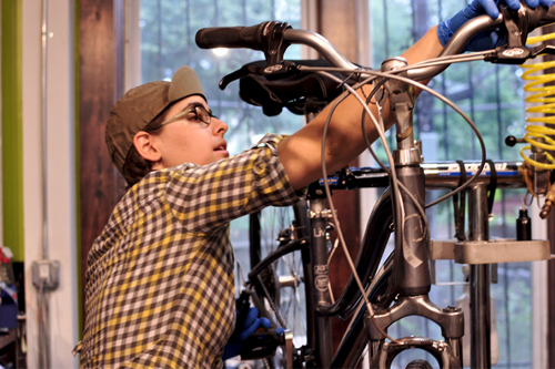 Nechama Levy Fixing a Bicycle