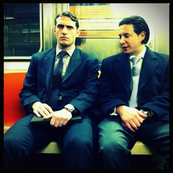 Men in suits do exist, and their legs do function. via flickr user Devyn Caldwell