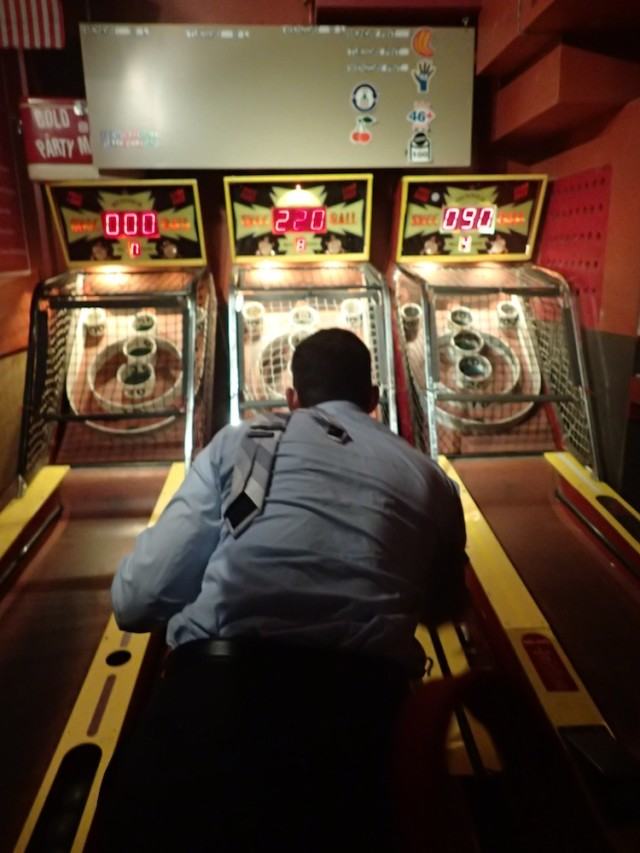 Full Circle Bar encourages tossing that tie over your shoulder and getting down business with Brewskee Ball.
