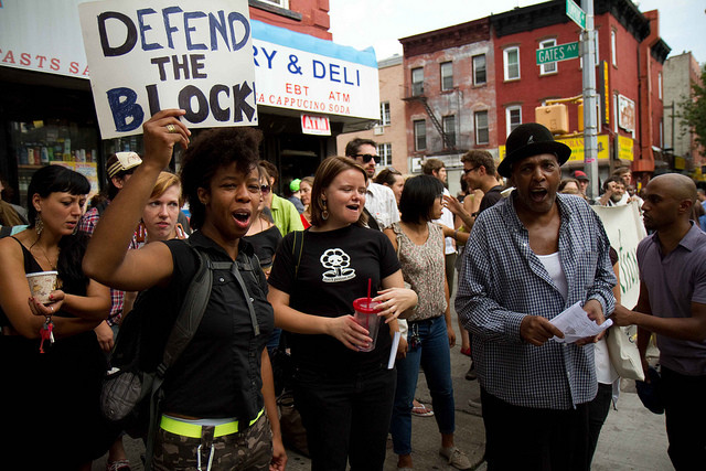 Residents protest the eviction of an elderly Bed-Stuy homeowner in 2011. Via Flickr user Michael Premo.