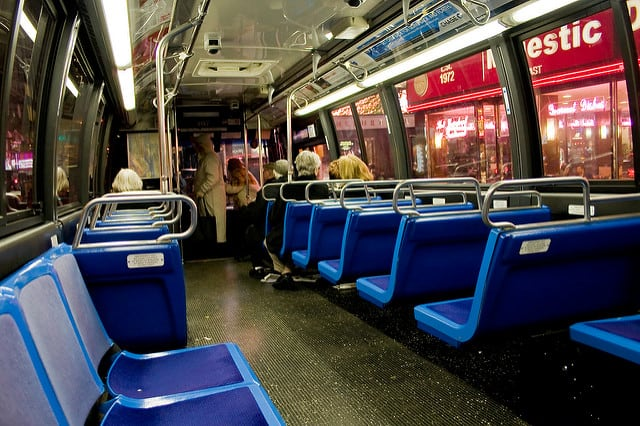 An empty bus at night is still chaperoned by the driver. Jason Kuffer / Flickr