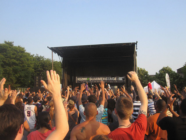 Hands up for Talib Kweli at the 2011 Red Hook Park Summerstage. Matt J Carbone / Flickr
