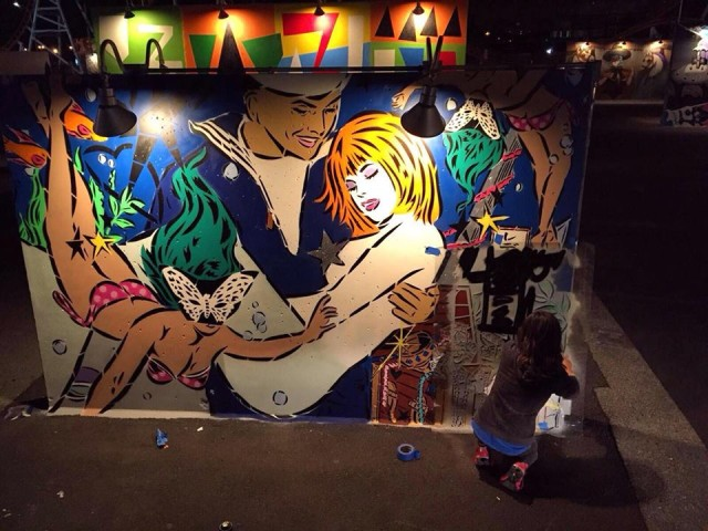 Lady Aiko finishing her Art Wall for 2016. Photo via Facebook.