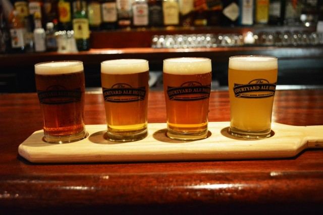 Buy a flight, then get your favorite for free with your Queens Beer Book ticket at Courtyard Ale House.