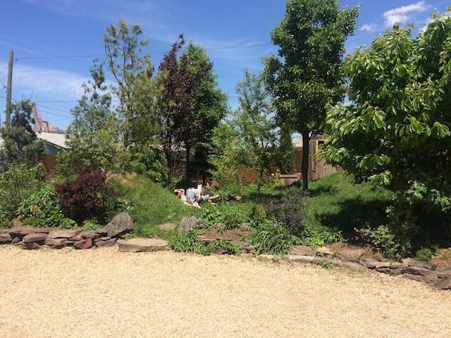 Folks enjoying lunch in the Pioneer Works' sunny backyard.