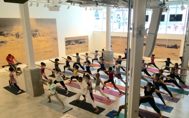 Yoga posers take over BRICs gallery every Friday during lunch. Photo by Abigail B. Clark.