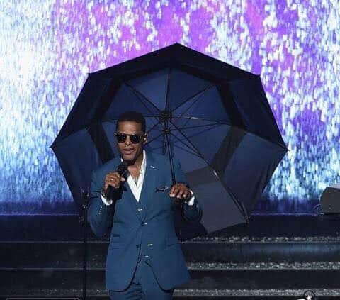 A still from Maxwell's stirring Prince tribute at this year's BET awards. See what they did there? With the umbrella and the rain? And the rain is purple? Because Purple Rain? UGH RIP PRINCE. Photo courtesy of Facebook.