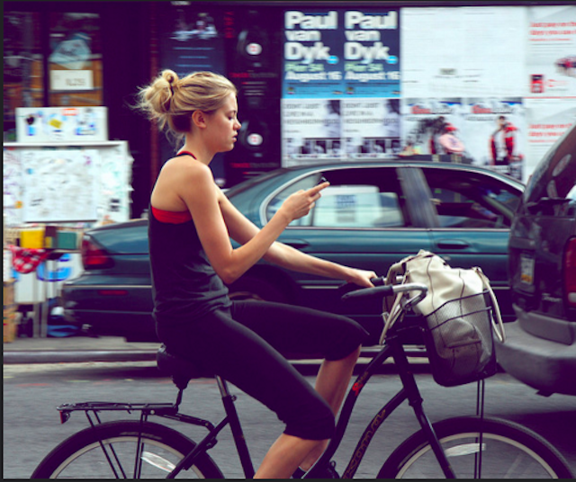 Don't be like this girl. Get the right gear so you can ride safely through the city.  Photo via Flickr