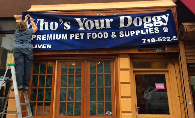 Calling all artists and animal lovers! Who's Your Doggy pet shop needs a new sign