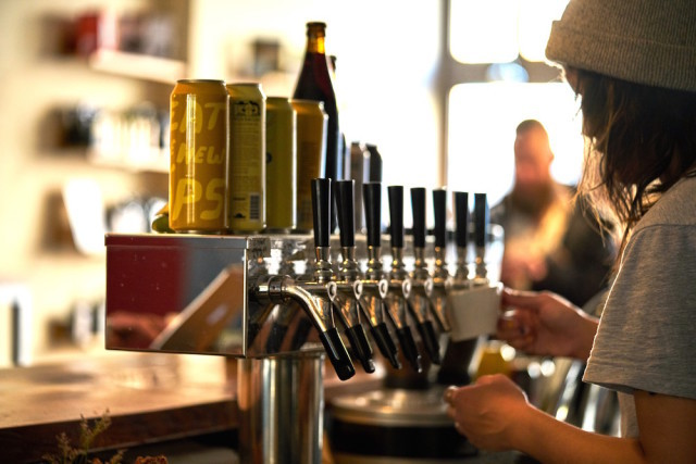 Try out the taps at Budin, one of the more than 30 bars in the Brokelyn Beer Book this year.