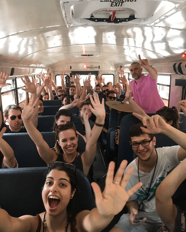 Here we have a bus full of a bunch of people and some instruments! Photo by Lilly Vanek/Brokelyn.