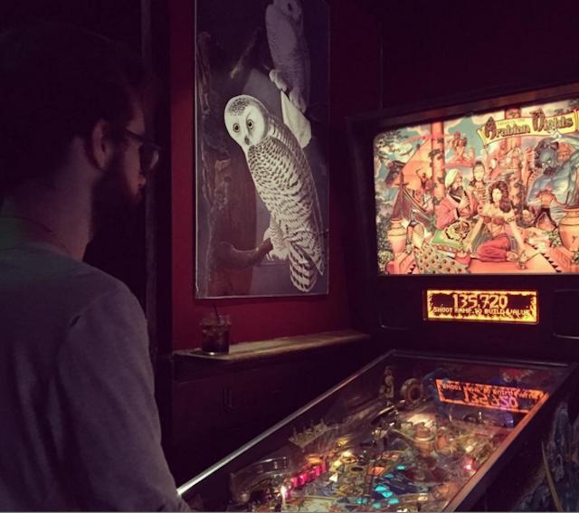 My friend playing the Arabian Nights machine at Owl Farm. Photo by Hope Morawa.