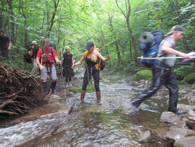 The group fjords a stream on the way to summit Balsam Mountain in the Catskills. Photo via Destination Backcountry Adventures.