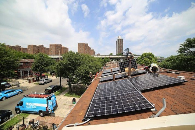Up on the roof. Photo via Malcolm Bliss/Level Solar
