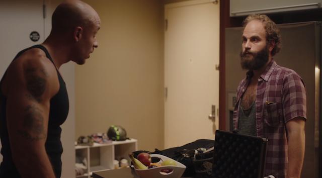 A tense drug deal scene, with a twist. Via screenshot.
