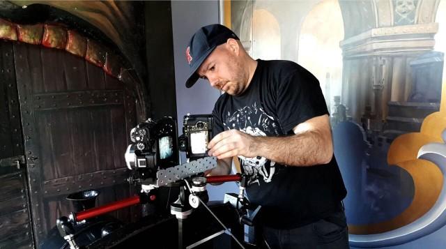 Joel Zika attaches his custom-built VR camera to a dark ride cart.