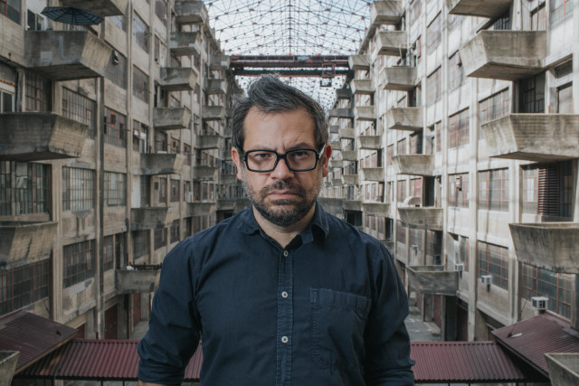 Artist Pedro Reys inside the army terminal, where Doomocracy is set. Photo by Will Star/Shooting Stars Pro.