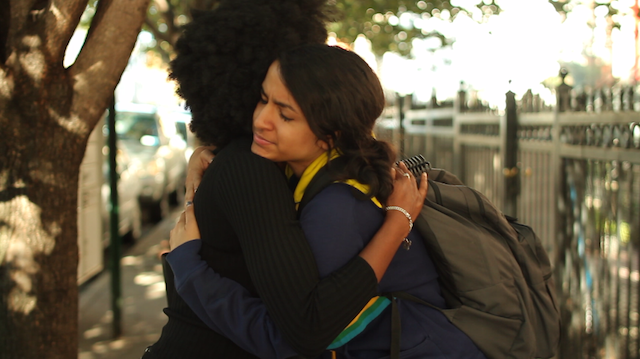 The heroines of 'Hustle' share a hug.