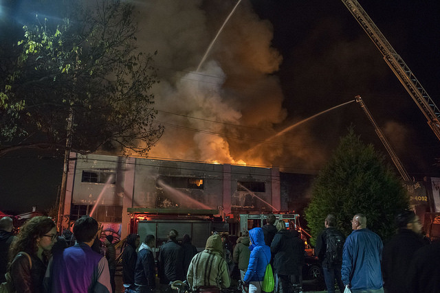 A huge fire consumed Oakland's Ghost Ship over the weekend, leaving more than 30 dead. Via Flickr user Julianna Brown.