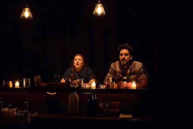 Julia Sirna Fest, left, and Jorge Cordova, right, two star-crossed barflies. Photo by Maria McClure