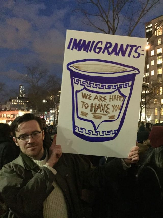 A sign riffing on the famous Anthora cup, which was designed by immigrant and Holocaust survivor Leslie Buck.