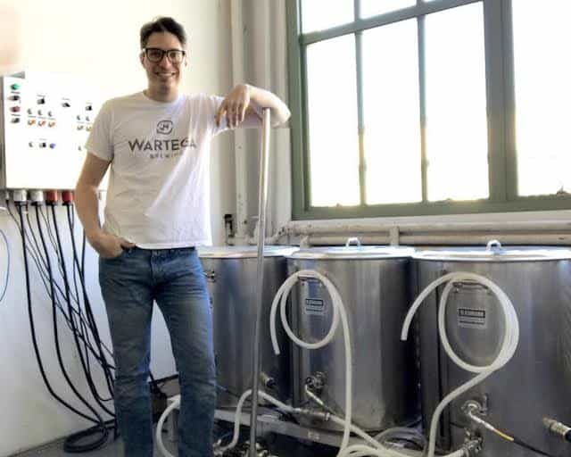 Wartega co-founder and brewer, Merlin U. Ward is ready to serve you bold beers out of these magical cauldrons