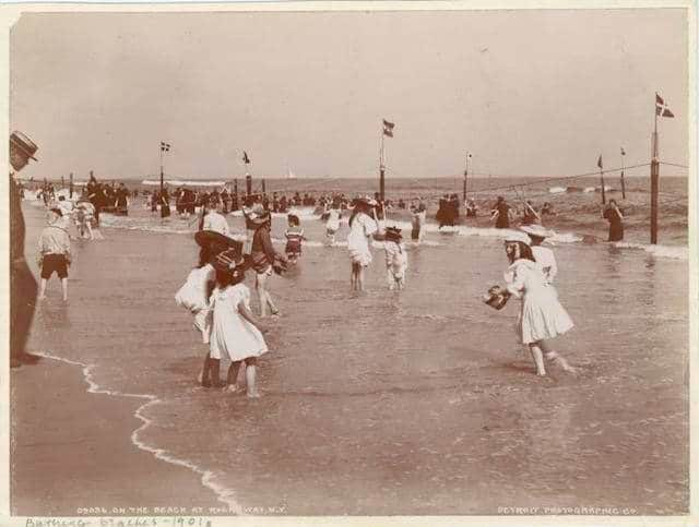 Rockin Rockaway Beach in the early 1900s in swimming gear which looks very bad for swimming. Photo via NYPL