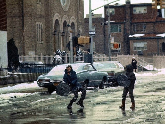 Snowball fight with garbage cover shields. Boro Park, Brooklyn 1976