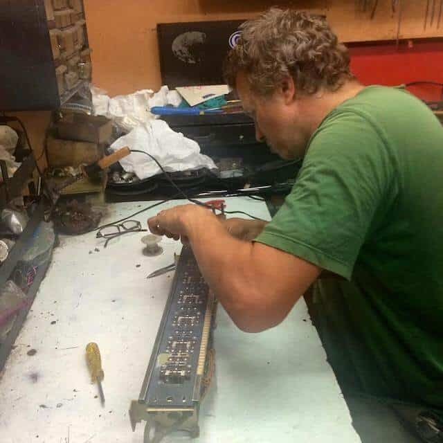 """Terry working on a Selector Assembly in Warren Rowe's workshop in California. Summer 2015."" Photo via New York Jukebox's Facebook"
