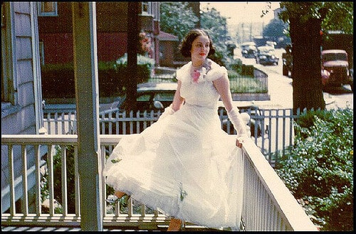 My Mom in her prom dress on the 13th Avenue side porch - 1948