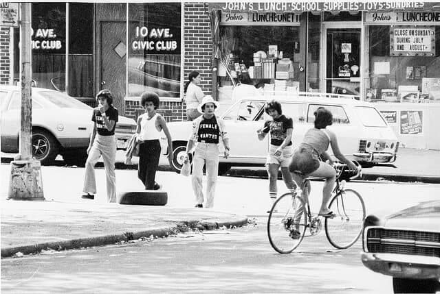 Note the 10 ave boys, eyeballing the current girl of their dreams on a bicycle built for one and in shorts no less. Dig a classic: John's Luncheonette. 1976