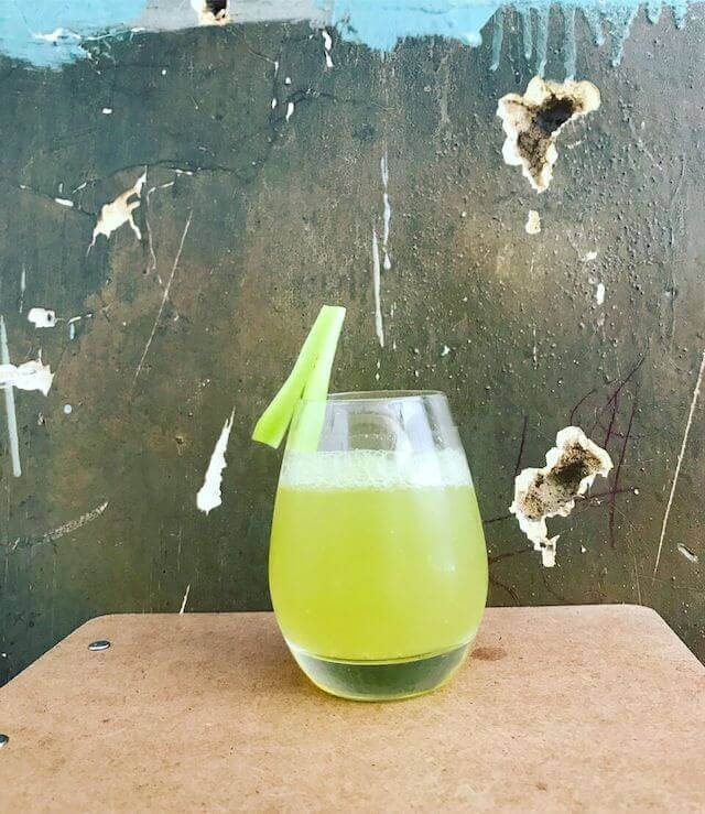 """A cocktail in front of a """"bullet-hole ridden wall"""". Photo via Summerhill"""
