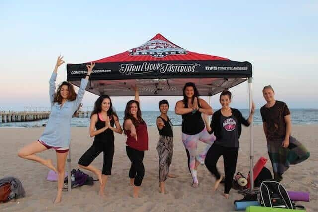 Coney Island takes beer yoga to the beach with their Mindful Pints program every Wednesday. Photo via Coney Island Brewery
