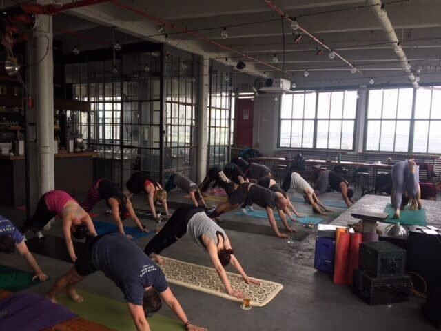 Wag your tail in the air like you just don't care at Wartega Brewing's beer yoga class.