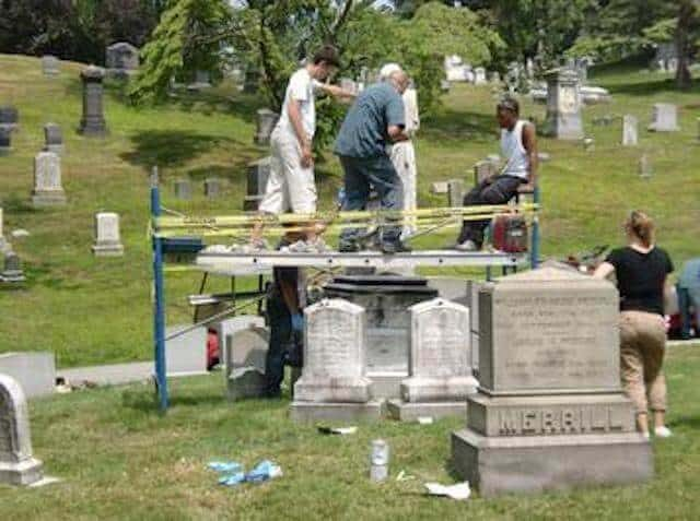 Past year's volunteers at Preservation Volunteers cleaning graves. Photo via Preservation Volunteers