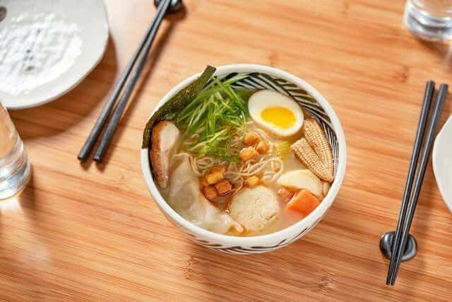 Score a free bowl of matzoh ball ramen soup with every drink order at this W'burg eatery