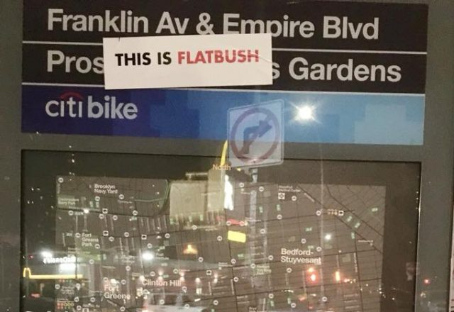 Vigilante putting 'This Is Flatbush' stickers over Prospect Lefferts Gardens signs