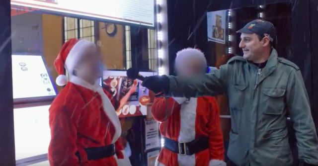 Video: What happens when you ask SantaCon Santas about racism in America
